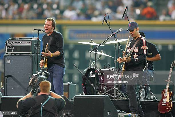 Jason Ross lead vocalist and guitar player for Seven Mary Three performs with Thomas Juliano on lead guitar before the Major League Baseball Legends...