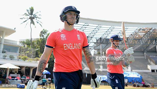 Jason Roy and Alex Hales of England walk out to bat ahead of the ICC Twenty20 World Cup Warm Up match between England and Mumbai Cricket Association...