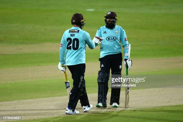 Jason Roy and Hashim Amla of Surrey punch gloves during the T20 Vitality Blast Final between Surrey and Nottinghamshire at Edgbaston on October 04...