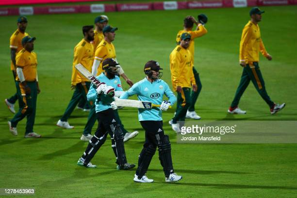 Jason Roy and Hashim Amla of Surrey take to the field to open the batting during the T20 Vitality Blast Final between Surrey and Nottinghamshire at...
