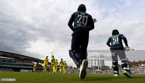 Jason Roy and Jonathan Bairstow of England head on to the field during the 1st Royal London ODI match between England and Australia at The Kia Oval...