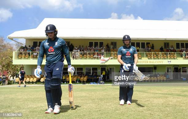 Jason Roy and Jonathan Bairstow of England walk out to bat during the One Day Tour Match between England and The University of West Indies Vice...