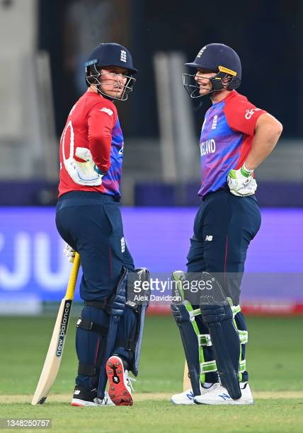 Jason Roy and Jos Buttler of England look on during the ICC Men's T20 World Cup match between England and Windies at Dubai International Stadium on...