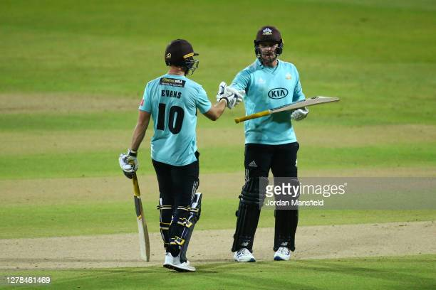 Jason Roy and Laurie Evans of Surrey punch gloves during the T20 Vitality Blast Final between Surrey and Nottinghamshire at Edgbaston on October 04...