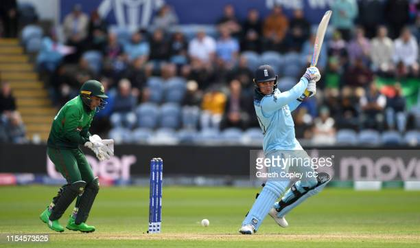 Jason Roy of England bats watched by Bangladesh wicketkeeper Mushfiqur Rahim during the Group Stage match of the ICC Cricket World Cup 2019 between...