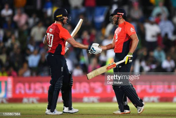 Jason Roy of England celebrates his 50 with Jonny Bairstow of England during the First T20 International match between South Africa and England at...