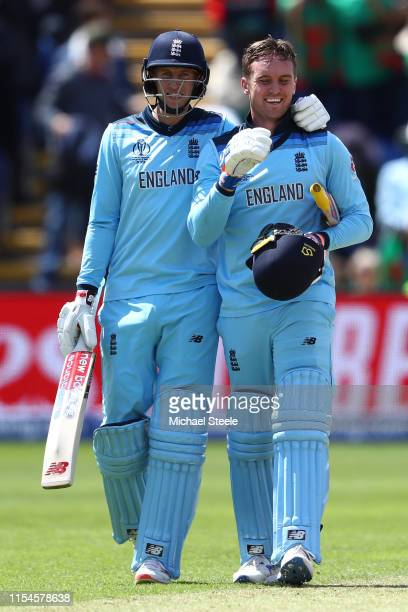 Jason Roy of England celebrates reaching his century alongside Joe Root during the Group Stage match of the ICC Cricket World Cup 2019 between...