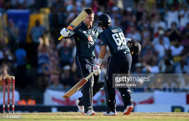 Jason Roy of England celebrates reaching his century during the 1st One Day International match between the West Indies and England at Kensington...