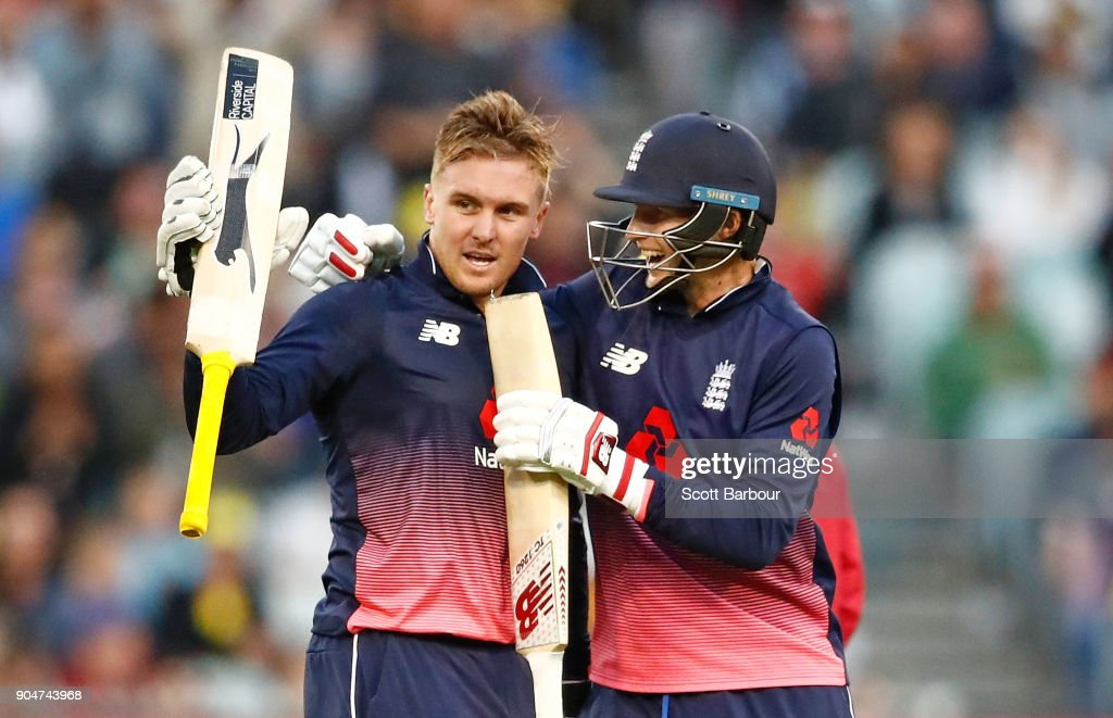 Jason Roy of England celebrates reaching his century with Joe Root during game one of the One Day International Series between Australia and England at Melbourne Cricket Ground on January 14, 2018 in Melbourne, Australia.