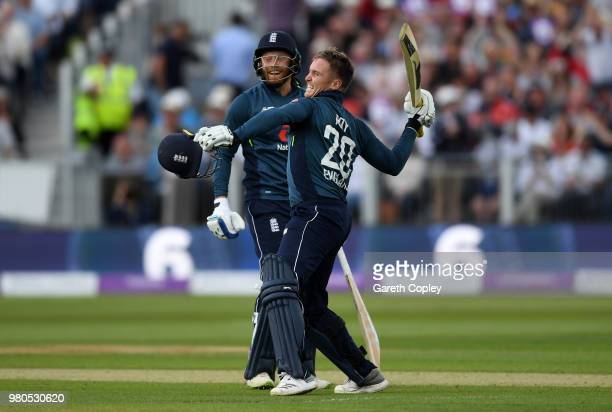 Jason Roy of England celebrates reaching his century with Jonathan Bairstow during the 4th Royal London One Day International between England and...