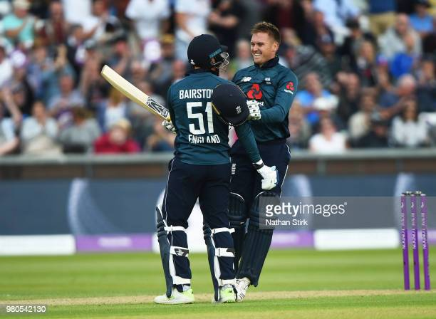Jason Roy of England celebrates with Jonny Bairstow after scoring 100 runs during the 4th Royal London ODI match between England and Australia at...