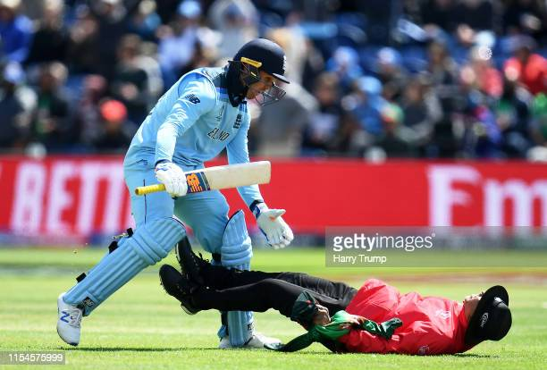Jason Roy of England collides with Match Umpire Joel Wilson as he prepares to celebrate his century during the Group Stage match of the ICC Cricket...