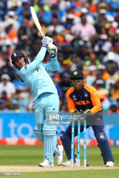 Jason Roy of England hits a straight off the bowling of Kuldeep Yadav as India wicketkeeper MS Dhoni looks on during the Group Stage match of the ICC...