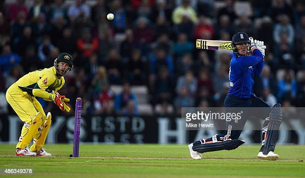 Jason Roy of England hits the ball straight to David Warner and is out for 67 as wicketkeeper Matthew Wade looks on during the 1st Royal London...