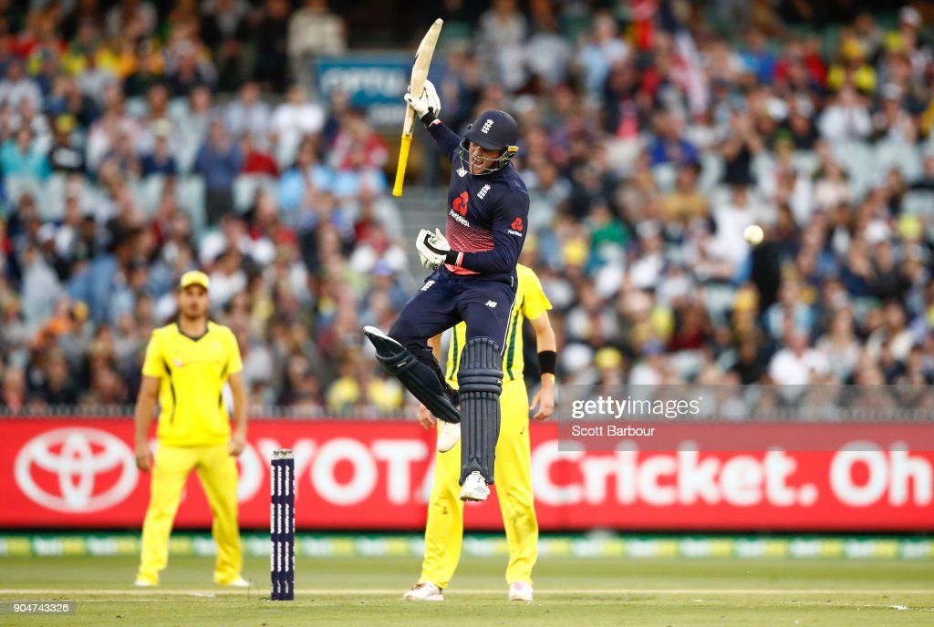 Jason Roy of England leaps in the air as he celebrates reaching his century during game one of the One Day International Series between Australia and England at Melbourne Cricket Ground on January 14, 2018 in Melbourne, Australia.