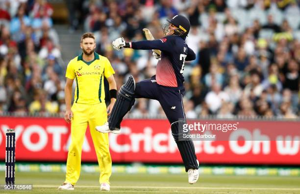 Jason Roy of England leaps in the air as he celebrates reaching his century during game one of the One Day International Series between Australia and...