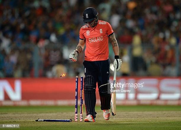Jason Roy of England leaves the field after being bowled by Samuel Badree of the West Indies during the ICC World Twenty20 India 2016 Final between...