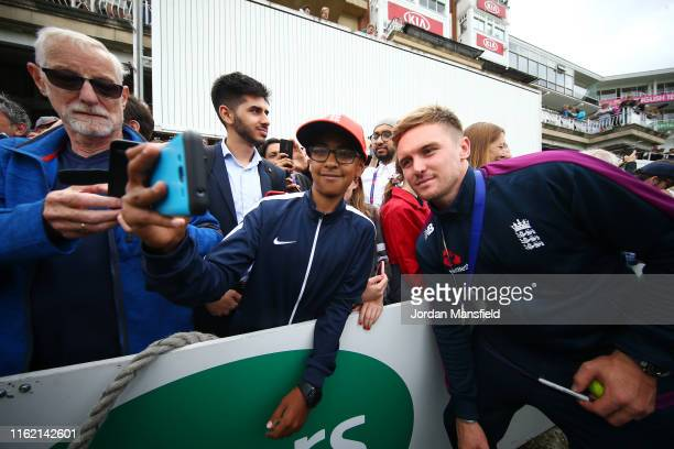Jason Roy of England poses for a selfie with a fan during the England ICC World Cup Victory Celebration at The Kia Oval on July 15, 2019 in London,...