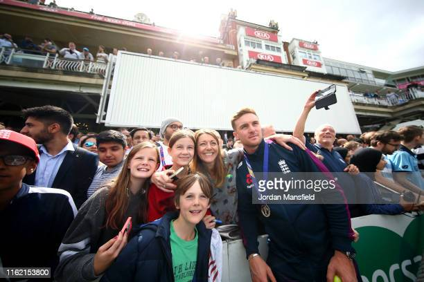 Jason Roy of England poses for a selfie with fans during the England ICC World Cup Victory Celebration at The Kia Oval on July 15, 2019 in London,...