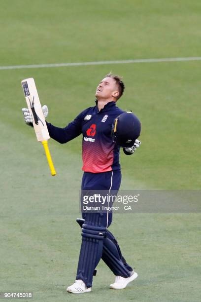 Jason Roy of England raises his bat after scoring 100 runs during game one of the One Day International Series between Australia and England at...