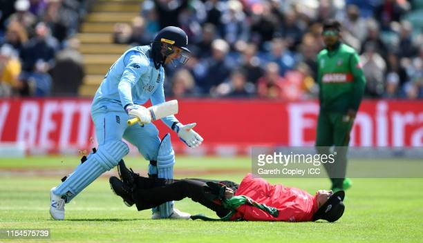 Jason Roy of England runs into umpire Joel Wilson as he celebrates his century during the Group Stage match of the ICC Cricket World Cup 2019 between...