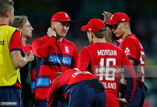 Jason Roy of England speaks with Eoin Morgan captain of England after claiming a catch hit by Glenn Maxwell of Australia which was later ruled not...