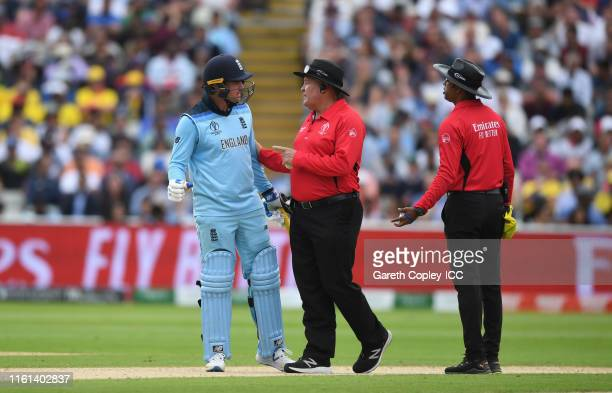 Jason Roy of England speaks with Umpires Handunnettige Dharmasena and Marais Erasmus after being given out during the SemiFinal match of the ICC...