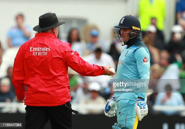 Jason Roy of England talks to the umpire Marais Erasmus after being given out trapped LBW during the Group Stage match of the ICC Cricket World Cup...