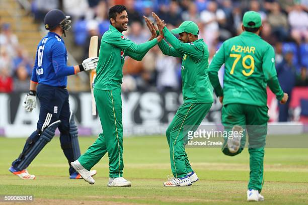 Jason Roy of England walks after being caught for 87 runs by Hasan Ali as bowler Mohammad Amir celebrates with Babar Azam during the 5th Royal London...