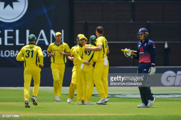 Jason Roy of England walks off after being caught out for a duck as Australian players celebrate during the fourth oneday international cricket match...
