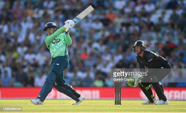 Jason Roy of Oval Invincibles bats watched by Manchester Originals wicketkeeper Jos Buttler during the Hundred match between Oval Invincibles and...