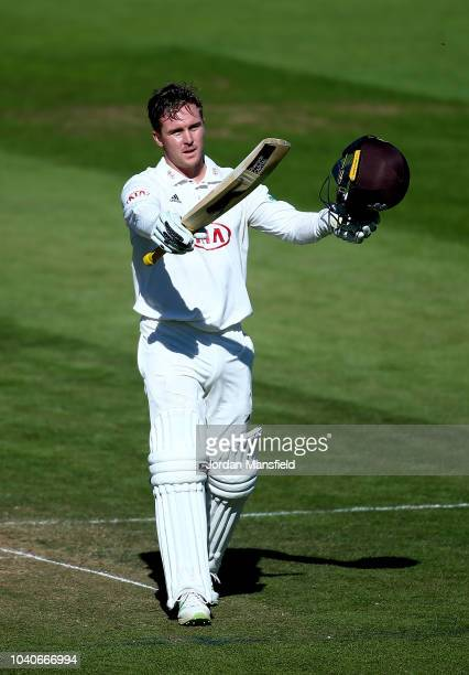 Jason Roy of Surrey celebrates his century during day three of the Specsavers County Championship Division One match between Surrey and Essex at The...