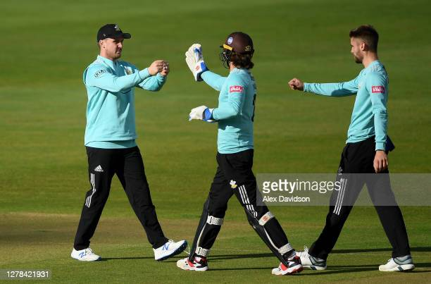 Jason Roy of Surrey celebrates the wicket of Ian Cockbain with Ben Foakes and Will Jacks during the Vitality Blast 2020 Semi Final match between...