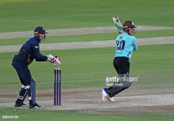 Jason Roy of Surrey hits out as Kent Spitfires wicket keeper Sam Billings looks on during the NatWest T20 Blast South Group match between Kent...