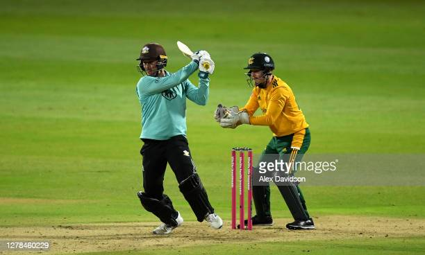Jason Roy of Surrey hits out watched on by Tom Moores during the Vitality Blast 20 Final between Surrey and Notts Outlaws at Edgbaston on October 04...