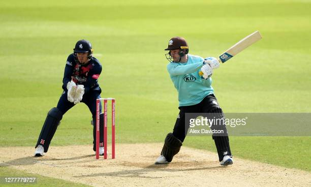 Jason Roy of Surrey hits runs watched on by Sam Billings of Kent during the Vitality Blast QuarterFinal match between Surrey and Kent Spitfires at...