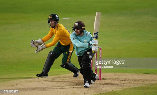 Jason Roy of Surrey hits runs watched on by Tom Moores of Notts during the Vitality Blast 20 Final between Surrey and Notts Outlaws at Edgbaston on...