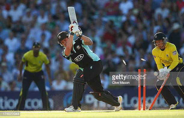 Jason Roy of Surrey is bowled watched by Michael Bates of Hampshire during the Friends Life T20 match between Surrey Lions and Hampshire Royals at...