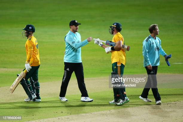 Jason Roy of Surrey punches fists with Dan Christian after defeat in the T20 Vitality Blast Final between Surrey and Nottinghamshire at Edgbaston on...