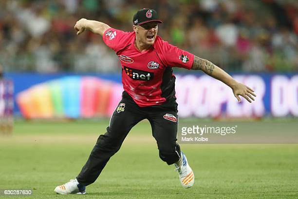Jason Roy of the Sixers celebrates taking he catch to dismiss Ben Rohrer of the Thunder during the Big Bash League match between the Sydney Thunder...