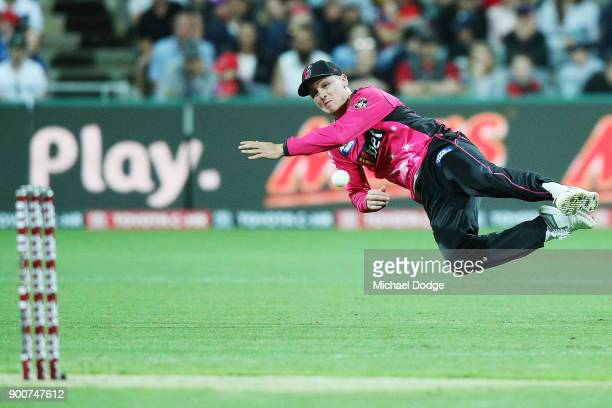 Jason Roy of the Sixers runs out Aaron Finch of the Renegades during the Big Bash League match between the Melbourne Renegades and the Sydney Sixers...