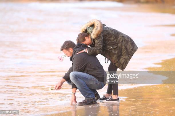 SYDNEY NSW Jason Ruszczyk Justine's brother and Katarina Ruszczyk attend a sunrise vigil for Justine Damond on Freshwater beach in Sydney New South...