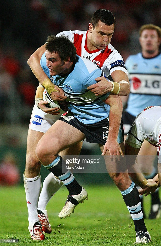 Jason Ryles of the Dragons tackles Luke Douglas of the Sharks during the round 13 NRL match between the St George Illawarra Dragons and the Cronulla Sharks at OKI Jubilee Stadium June 11, 2007 in Sydney, Australia.