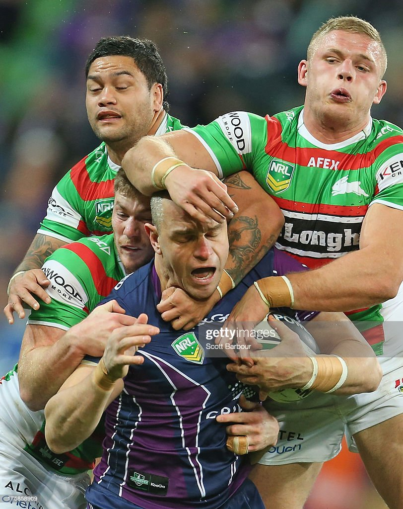 Jason Ryles of the Storm is tackled during the round 22 NRL match between the Melbourne Storm and the South Sydney Rabbitohs at AAMI Park on August 9, 2013 in Melbourne, Australia.