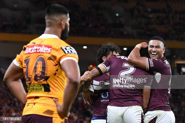 Jason Saab of the Sea Eagles celebrates with team mates after scoring a try during the round 10 NRL match between the Manly Sea Eagles and the...