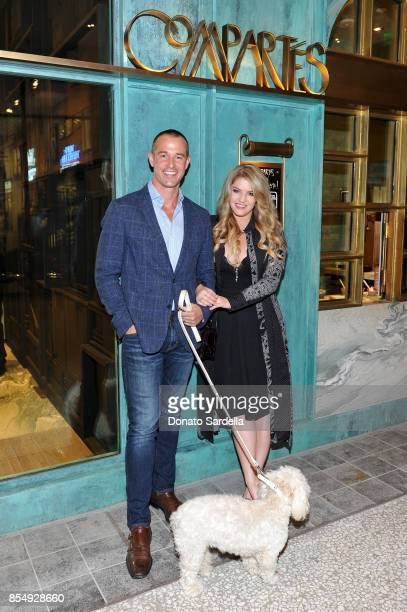 Jason Sabo and Pandora Vanderpump celebrate the Compartes Chocolatier Century City Flagship Store Opening on September 27 2017 in Los Angeles...