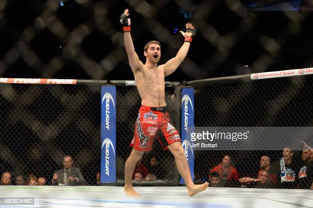 Jason Saggo celebrates after a defeating Josh Shockley by TKO during the UFC 174 event at Rogers Arena on June 14, 2014 in Vancouver, British...
