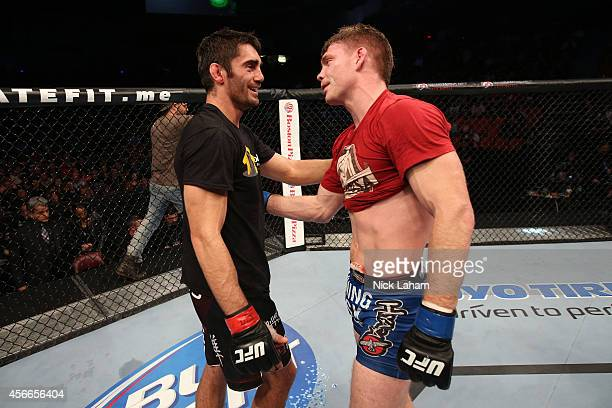 Jason Saggo of Canada and Paul Felder show a display of sportsmanship after their lightweight bout at the Scotiabank Centre on October 4 2014 in...