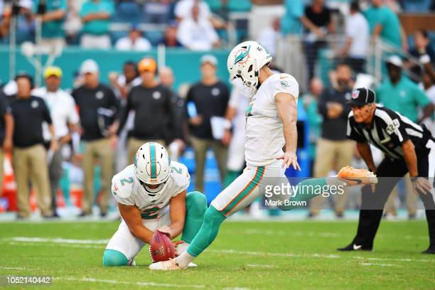 Jason Sanders kicks the game winning field goal against the Chicago Bears in overtime at Hard Rock Stadium on October 14 2018 in Miami Florida