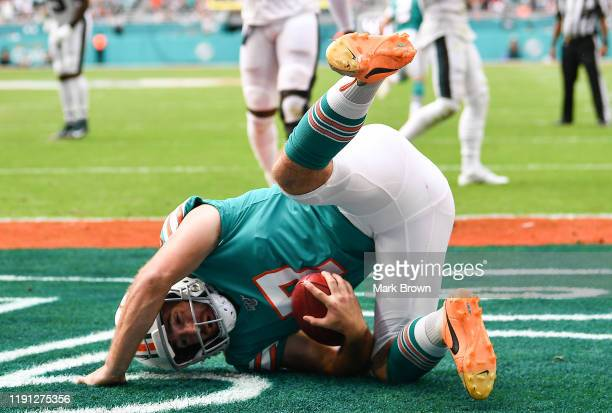 Jason Sanders of the Miami Dolphins catches a touchdown pass from a fake field goal against the Philadelphia Eagles in the second quarter at Hard...